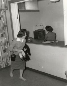 A student sneaks past the dormitory check-in desk. Historic Photographs of Southwest Louisiana