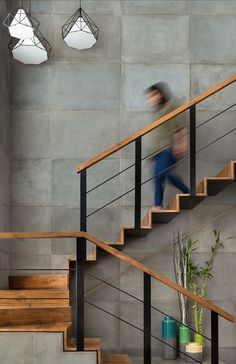 Contemporary stair case with wood and metal details.