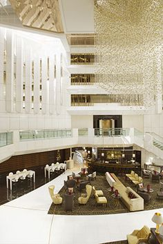 """""""[The structure's] graceful delicacy tones down the masculine feel of the architecture, resulting in a more relaxed ambiance that elevates the hotel's cachet and luxury appeal,"""" she explains. """"The soaring height of the lobby called for something quite amazing to escalate its wow factor and add a touch of glamor."""""""