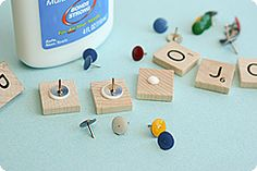 Glue thumbtacks onto Scrabble tiles and you have letter pushpins