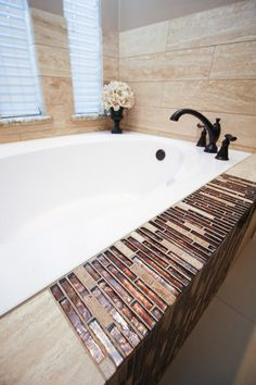Here is a stunning installation using our Dore Select and Vista Sight as a Mosaic accent! #unique #tile #installations #design #interiordesign #designer #tiles #walltile #flooring #mosaic  #traditional #classic #look #accent #strip #bathroom #bathtub  #southern #living #homedecor #decor #forthehome #emsertile