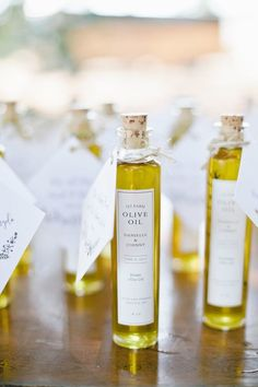 16 Personalized Wedding Favors Your Guests (And You!) Will Totally Love Take your guest gifts to the next level with our roundup of the best personalized wedding favors that your guests will love (and use post-wedding! Wedding Favors And Gifts, Olive Oil Wedding Favors, Creative Wedding Favors, Inexpensive Wedding Favors, Elegant Wedding Favors, Edible Wedding Favors, Wedding Favor Boxes, Personalized Wedding Favors, Bridal Shower Favors