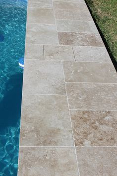 Why Your Pool Needs Coping: 1, Prevents water from penetrating the area behind pool shell and potentially causing damage Keeps grass, leaves ect out of pool. 2, Beautifully frames your pool and can hide unattractive mechanical components such as pool covers. 3,Provides swimmers a safe and sturdy way to enter and leave the pool reducing the risk of slipping Coping Stone, Pool Pavers, Swimming Pool Tiles, Pool Coping, Dartmoor, Glass Mosaic Tiles, Swimmers, Travertine, Natural Stones