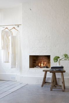 Atelier Fireplace - Fashion designer Anna Valentine's bright modern London flat, restored with the same air of easy elegance as her clothing line - real homes on HOUSE by House & Garden Modern White Living Room, White Rooms, Grey Wall Clocks, Country Living Decor, Swedish Decor, Minimalist Home Interior, Fireplace Wall, Home Decor Styles, House