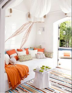 nearly all white decor, accented with neutral colors and bright orange... surprisingly restful looking!
