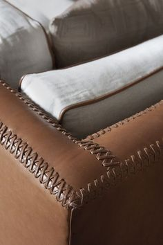 This baseball stitching is one of my favorite details on the sofa. It's the Black's Beach sofa by Tim Clarke, made of leather, linen and brushed steel.