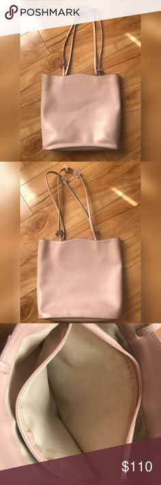 """Furla Pink Italian Leather Designer Shoulder Bag Originally 345 from  Nordstrom , a Furla designer handbag gifted to me by my husband. I hate getting rid of it because I love it still. Very feminine , pale pink  with flowers accenting the straps , 11-&1/2 """" shoulder straps. 3 pockets , 1 zippered in the middle , 2 side pockets for easy access, deep enough to keep contents safe. Still looks great, but some surface nicks & a small water stain inside - very nice bag still. 12"""" wide 10&1/2"""" h…"""