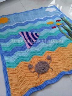 Scenic blanket, crochet. Underwater scene on a ripple background.