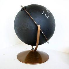 Chalkboard Globe... I love this idea, and it would be OH-SO easy to do with some chalkboard spray paint and an old globe (found at a thrift store)