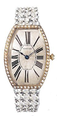Cartier Tonneau wristwatch,  Paris 1907  Cartier lead the way with luxury wrist watches. As early as 1888 they  offered ornamental ladies wrist watches, this concept really took off after 1904.