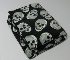 Skull fleece blanket...in order to be assured of having the very coziest nightmares. Aaahhh...