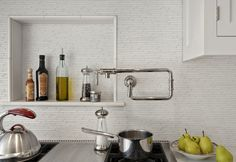 A niche above the cooktop is a great place for everyday oils, spices and seasoning- Crisp Architects