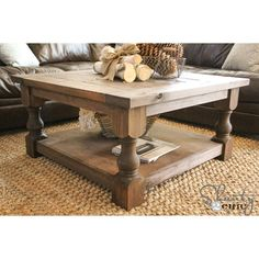 Creative DIY Coffee Table and great decor ideas...burlap wrapped birch logs, pine cones in chicken wire basket...