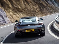Aston Martin's is the gorgeous Bond car of the future Aston Martin Models, Aston Martin Db11, Front Brakes, Rear Brakes, V Engine, Bond Cars, Automatic Cars, Combustion Engine, Rear Wheel Drive