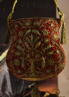 Red velvet with gold thread embroidery and gold thread tassels16th century.