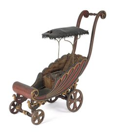 Carved and painted stroller, late 19th c., reta
