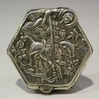 A Continental silver hexagonal box and cover, possibly Greek, the top cast in relief with St. George