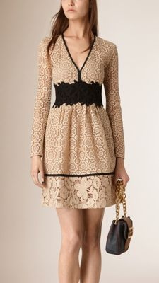 Burberry empire line dress in contrasting lace panels. The fitted design is constructed from three-dimensional floral macramé and intricate lace threadwork woven at a 100-year-old mill in Switzerland. Discover the women's dress collection at Burberry.com