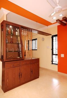 Wooden ✨ Storage Cabinet serve as a Bar Table with Wooden Display Cabinet having Glass Shelf & Glass Doors & Wooden Poles above it works as a Room Divider - GharPedia Wooden Display Cabinets, Wooden Poles, Industrial Interior Design, Cabinet Design, Glass Shelves, Storage Units, House Design, Glass Doors, Krishna