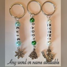 Handmade Personalised Key Chain with Christmas Charm. Handmade beaded key chain / key ring / bag charm Can be personalised with any name or wording - available in three styles, Snowflake, Christmas Tree or Snowman Ideal stocking filler or little gift or bag charm for school bags Other coloured beads and charm styles are available on request. All items come in an organza gift bag.