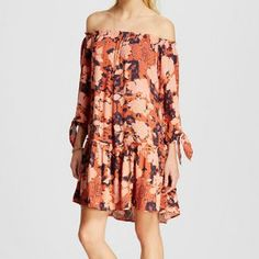 Meeting for drinks after a day on the shore? This floral long-sleeve dress hits all the right notes with its subtle color palette.