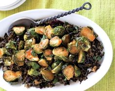 I realized that serving the Brussels sprouts atop my favorite wild rice dish would create a stunning entrée Vegetarian Thanksgiving, Thanksgiving Recipes, Sriracha, Rice Dishes, Vegetable Dishes, Entrees, Wild Rice, Brussels Sprouts, Vegan Recipes