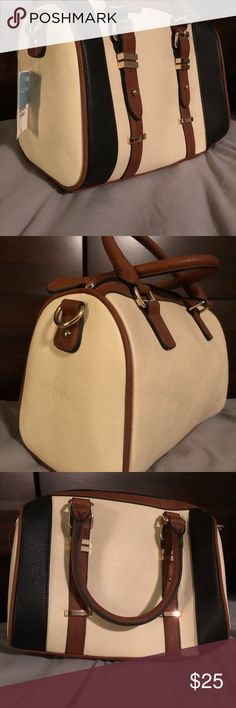 """NWT- Duffle style / """"speedy"""" style purse Never used duffle style purse in tan, black and cream Bags Hobos"""