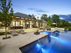 Eco Outdoor Capri travertine pavers used in contemporary pool design.