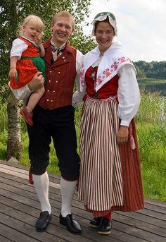 family wearing Swedish folk costume