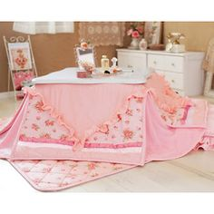 A kotatsu (heated table) And a very cute one! I want to sit under one of these on a very cold day...