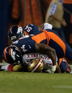 Colin Kaepernick (7) of the San Francisco 49ers is sacked by DeMarcus Ware (94) of the Denver Broncos in the first quarter. The Denver Broncos played the San Francisco 49ers at Sports Authority Field at Mile High in Denver on October 19, 2014. (Photo by AAron Ontiveroz/The Denver Post)-- #ProFootballDenverBroncos