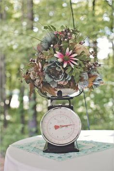 old scale for wedding centerpiece- got em at Railroad Towne Antique Mall, 319 W 3rd St, Grand Island, NE, 308-398-2222