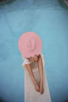 Poolside model wearing a pink hat // Pastel, candy colours   Beach   Surf   Fashion   Girls   Lifestyle   Wetsuits   www.saltbeat.com