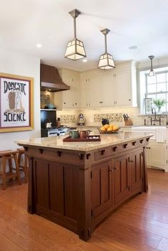 """From """"8 Elements of a Craftsman Kitchen"""" article on Houzz.com. Love the light fixtures."""