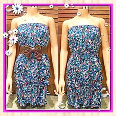 Strapless Summer/Spring Dress Offer $3 under list price so we can split the cost of shipping! Adorable strapless dress w/blue, pink, green, & white floral design, elastic waist/under bust, elastic top, small string belt loops on each side, & layered ruffle bottom. No holes, stains or pilling. Belt not included. No inside tag for brand or size. Juniors size large/women's medium (best guess on how it fits me) Great pre-loved condition! ⭐️⭐️⭐️⭐️ ✅ASK QUESTIONS ✅Bundle ✅REASONABLE Offers ❌NO…