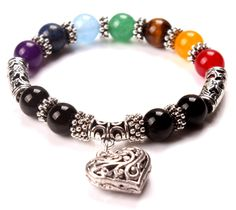 Beautiful and versatile 7 Chakra Bracelet with Heart charm. Colorful stones and healing crystals. Also available with wooden beads, healing stones and Heart charm. Don't wait to add this to your Yoga Fashion Style.