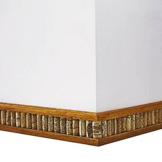 How to create a baseboard with wine corks.  Really cool idea!   thisoldhouse.com