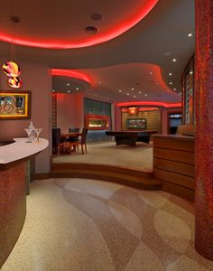 Bar opens to Game Room & Media Room - note cove lighting...