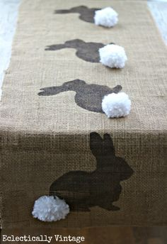 See how to make this burlap bunny table runner - a fun Easter craft! eclecticallyvintage.com