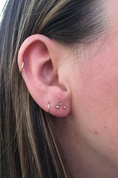 "L.A.'s Raddest Trend: Constellation Piercings #refinery29  http://www.refinery29.com/2016/10/126285/body-piercing-constellation-la-trend-photos#slide-1  If your first lobe piercing is off-center — maybe because your best friend did it for you in the sixth grade — this triangle shape is a great option. ""You can take something that you're not happy with and give it a brother and sister, and...it becomes something that you're totally stoked about again,"" Thompson says. ..."