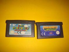dos juegos game boy advance mario party y super mario world 2