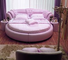 Round pink leather bed.. total princess bed!