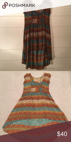 """Free People hi-low floral dress Gently used dress. No damages.  5'7"""" and 125lbs, 32B. Free People Dresses High Low"""