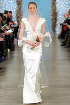 Love the shoulders on this Oscar de la Renta dress