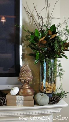 How to Create a Fall Vignette, love the magnolia, as well as the corks in the bottom of the urn.