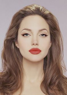 Simple... Black winged eyeliner, mascara and red lipstick.