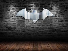 Batman Logo Mirror. No bat cave is complete without this cool Batman Logo Mirror. This mirror measures 28 Inches x 13 Inches and is perfect gift idea for any Dark Knight wanabee!