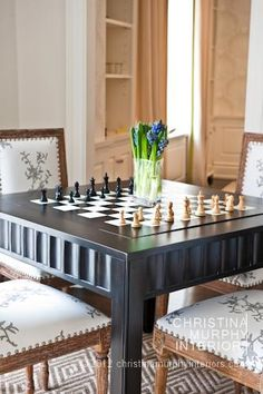 Dave would love to have a chess game going all the time.  I would love to have the flowers.  :)  Interior ideas from Christina Murphy Interiors