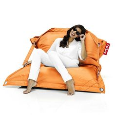 Fatboy Buggle-Up Bean Bag - Orange: Combining comfort with an outdoor lifestyle, the Buggle-up is the ideal complement to your garden or terrace.  Its tough fabric can withstand UV rays, water and dirt and its ingenious design means it is both a perfect leisure chair for one or an intimate snuggle sofa for two – you can switch effortlessly between the two.  The Buggle-up is available in 16 colours, ranging from Yellow Ochre and Pink for a quirky contemporary look to Taupe and Black for…