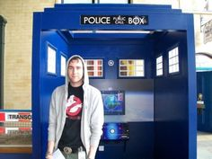 Neville standing in a TARDIS with a Ghostbusters shirt...we just need a Star Trek communicator and a lightsaber and we're golden